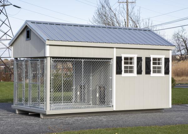 small residential kennel in gray